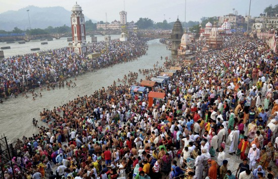 Hindu devotees gather on the banks of the River Ganges to take holy dips on the auspicious occasion of Somvati Amavasya in Haridwar, India, Monday, May 18, 2015. Somvati Amavasya is the no moon day that falls on a Monday in a traditional Hindu lunar calendar. It is a rare occurrence in a year and is considered highly auspicious. (AP Photo/Sandeep Sharma)